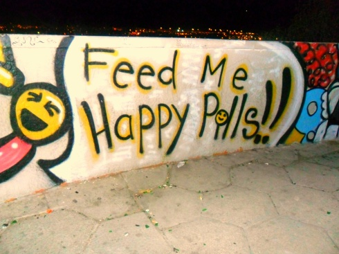 somebody feed this graffiti artist happy pills already