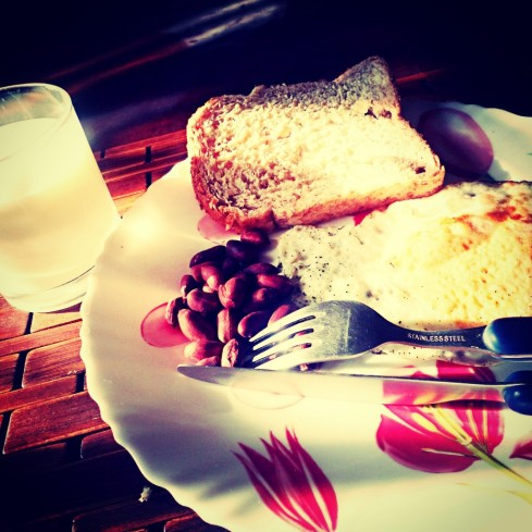 Whole wheat bread, ground nuts, sunny side up egg and a glass of milk