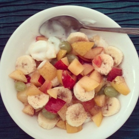 Fruit salad: banana, grapes, plums and apples